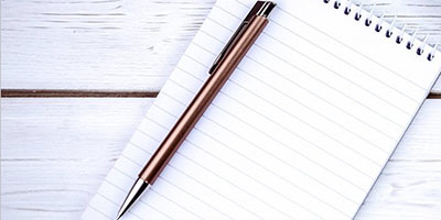 Image of a pen and notebook