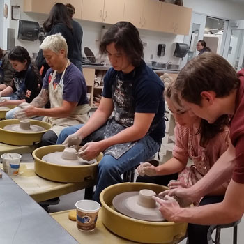Students working on pottery in the craft center