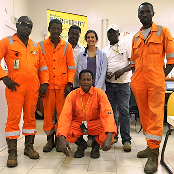 Ariana Chedraui posing with crew members in Gabon.