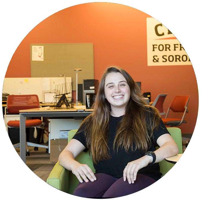Allison Starkenburg sitting and smiling