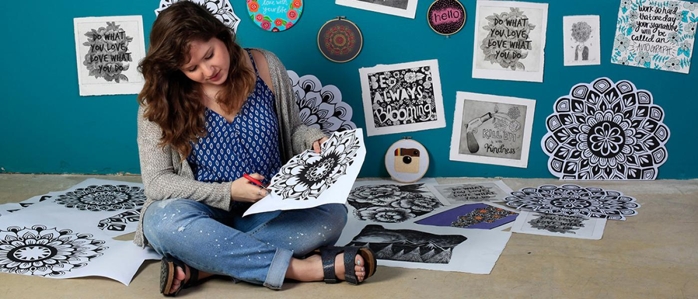 Feature story image, Lauren Salgado working on a creative project
