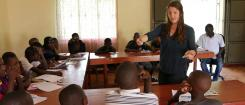 Feature story image, Grace Burleson teaching Ugandan children