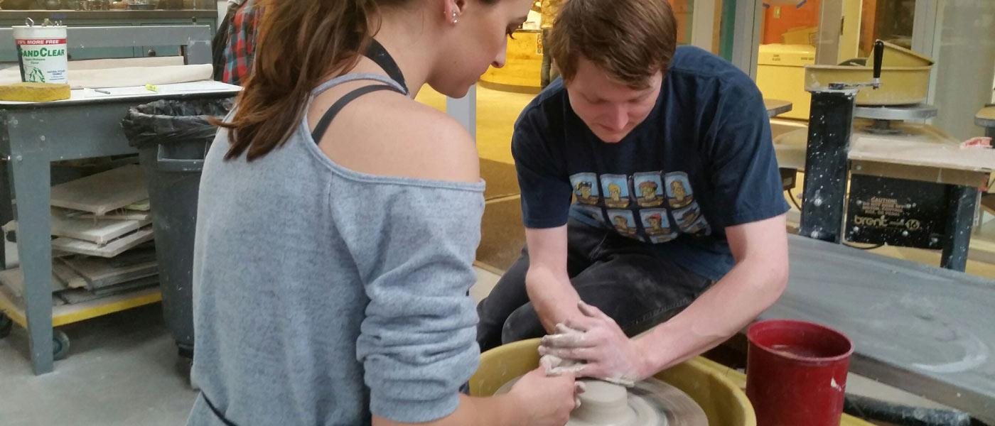 Students working on pottery together