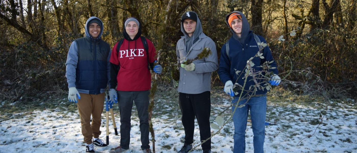 Students pose during the MLK Day of Service while working at Martin Luther King Jr. Park.